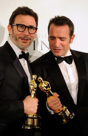 Last year's winner for Best Director for 'The Artist' Michel Hazanavicius and Actor Jean Dujardin, winner of the Best Actor Award for 'The Artist,' show off their Oscars after the Academy Awards in 2012. Frazer Harrison/Getty Images/AFP