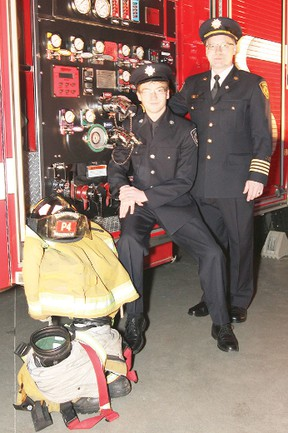 Capt. Alex Plant and his son Brian pose for a portrait during the Firemen's Ball at the Drill Hall March 2. The Plants have always had a member of their family volunteering with the local fire services since its inception 110 years ago.