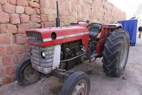 """Noel Beach, a Brantford resident, sent this photo of a Massey Ferguson tractor that he spotted during a trip to Morocco in the fall. Beach was in the village of Bhalil, where there are still a number of cave dwellings in use. He had just left and was outside the town wall when he saw this tractor. """"Obviously it had seen better days but I just had to snap a photo,"""" Beach said."""