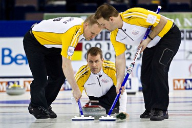Manitoba skip Jeff Stoughton delivers a shot during the 2013 Tim Hortons Brier at Rexall Place in Edmonton, Alta., on Saturday, March 9, 2013. Codie McLachlan/Edmonton Sun/QMI Agency
