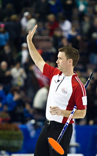 Newfoundland and Labrador skip Brad Gushue waves to the audience after losing to Ontario during the 2013 Tim Hortons Brier bronze medal game at Rexall Place in Edmonton, Alta., on Sunday, March 10, 2013. Codie McLachlan/Edmonton Sun/QMI Agency
