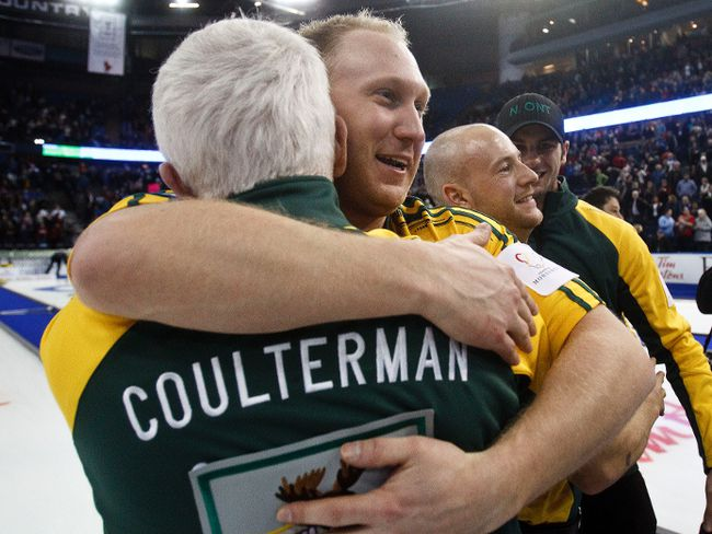 Brad Jacobs gives coach Tom Coulterman a hug.