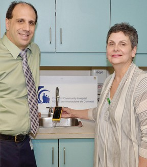 Mario Alibrando, director of information technology, and Nancy-Ann Bush, manager of infection prevention and control, at the Cornwall Community Hospital, show off the new Xperia Go.  Submitted photo