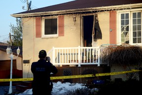 TRENTON, ON (03/12/2013) A member of the Quinte West OPP takes photos at the scene of a deadly house fire in Trenton on the morning of Tuesday, March 12, 2013.  One man died in the fire while six others, including three children, escaped.  EMILY MOUNTNEY/TRENTONIAN/QMI AGENCY