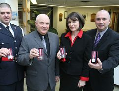 Four members of the North Bay Police Association were awarded the Queen's Diamond Jubilee Medal during the Police Services Board Meeting Tuesday. From left, Const. Merv Shantz, Ivan Ryman, forensic identification officer, Aline Major, administrative assistant and Sgt. Noel Coulas display their medals. The association nominated a number of its members. Tuesday's recipients join almost a dozen others who have also received the medal including Police Chief Paul Cook, Retired Deputy Chief Al Williams, Deputy Chief Shawn Devine, Staff Sgt. Mike Tarini, Const. Jody DeHaas and Const. Aaron Northrup.