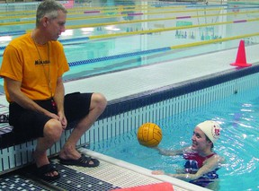 Dave Hill, coach of the Queen's University Varsity men and women's polo teams, speaks with Emily Ready, a player and lead instructor of the I Love Water Polo youth program, which is offered through Queen's University.     Justin Smith-Kingston This Week