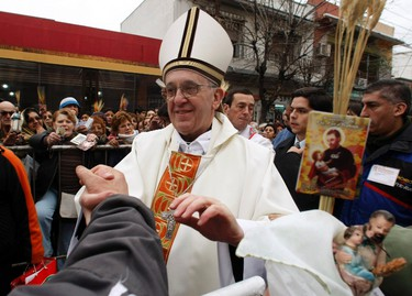 Archbishop of Buenos Aires Cardinal Jorge Mario Bergoglio greets worshippers, in the Buenos Aires neighbourhood of Liniers, in this August 7, 2009 file photograph. Bergoglio was elected Pope to succeed Pope Benedict on March 13, 2013, and took the name of Pope Francis. REUTERS/Marcos Brindicci