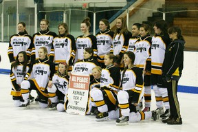 Dunvegan Dynamite Bantam girls with the league banner after their winning game
