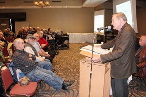 SEAN CHASE   Brian Crane, Ontario chief negotiator for the Algonquin land claim, speaks to a packed room at the Best Western Thursday night. Residents learned that 117,500 acres of Crown land are slated to be transferred to Algonquin ownership under the land claim's preliminary agreement-in-principle.