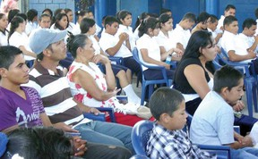 Audience members listen to speeches at the opening of a classroom at Los Almendros high school in Suchitoto, El Salvador, in February. (CONTRIBUTED PHOTO)