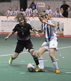 Wolves player Payton Esau (6) and Calgary's Rae Ann Rigal battle for ball possession during the first half of the round robin game between the Grande Prairie Wolves and CNS Titanium of Calgary on Friday, March 15, 2013. The Wolves are hosting the U16 Tier 2 Alberta Soccer Indoor Provincials in Grande Prairie, Alberta, March 15-17, 2013.   TERRY FARRELL/DAILY HERALD-TRIBUNE/QMI AGENCY