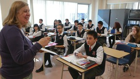 Students and their teacher crunch the numbers during math class at St. Patrick Secondary Catholic School on Felstead Ave. (DAVE THOMAS/Toronto Sun)