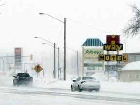 Cars travel along Saskatchewan Ave. during a snow storm, Monday. Drivers are being advised to drive with caution and drive for the weather as many roads across the province are snow and ice covered. (ROBIN DUDGEON/PORTAGE DAILY GRAPHIC/QMI AGENCY)