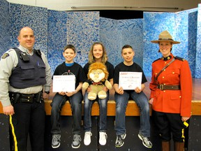 The RCMP constables who taught their D.A.R.E. (Drug Abuse Resistance Education) pose for a photo with the three Sangudo Community School Grade 6 students who made presentations at their graduation on Wednesday, March 13. They are, from left, Const. Shaun Provost, Calder Thompson (a news article), Daryka Kerr (a news article) Dawson Preston (an essay) and Const. Megan Olynek.