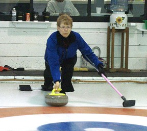 Skip Debbie Olsen takes her shot Friday, March 15. They were competing in the first game of a Mixed Bonspiel held at the Mayerthorpe Curling Rink. The action continued through to Sunday, March 17.