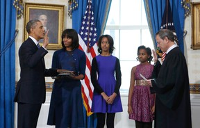 U.S President Barack Obama (L) takes the oath of office from U.S. Supreme Court Chief Justice John Roberts (R) as first lady Michelle Obama holds the bible and daughters Malia (3rd-L) and Sasha look on in the Blue Room of the White House in Washington, January 20, 2013. (REUTERS/Larry Downing)