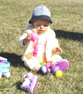 Eight-month old Shea Roberts has some fun with easter eggs in April 2012. (File photo)