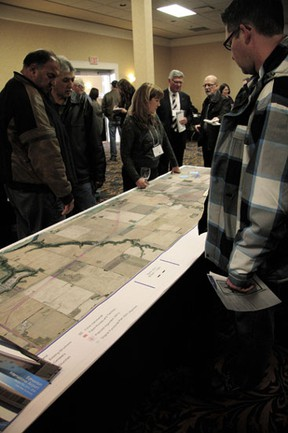 Maps and graphs laying out a potential route for a twinned Highway 19 were viewed by hundreds of residents at the Tuesday, Mar. 19 open house.