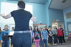 A.B. Daley Students practice the songs they were singing for the High River Lion's Music Festival.