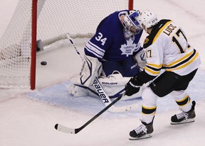 Bruins forward Milan Lucic scores a goal on Maple Leafs goaltender James Reimer on Monday night in Boston. (Reuters)