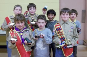 Pictured above are the winners of the Pack Kub-Kar races; back row Dakota Coldwell, Branden Crombeen, Jaydn Chin and Jackson Gattesco. Front row: Ryan Morley, Connor Laurich and Hayden McCulloch. Pictured right is Cub Daniel Griffin working on his Kub-Kar.