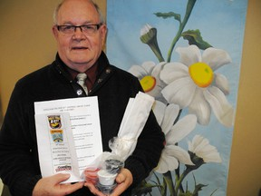 SARAH DOKTOR Times-Reformer Larry Dawson, executive director of the downtown Simcoe Business Improvement Area, holds one of kits provided by the BIA for  its downtown Simcoe Drive-Thru Art Gallery. Kits are available not and must be returned by May 15.