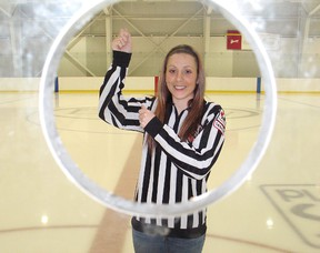 Julie Dexter has been invited to go far north to officiate a girls hockey tournament in Iqaluit, Nunavut this weekend. Here she poses for a photo at the Benson Centre.