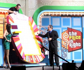 Mark Murphy was playing the Price is Right Live game Plinko at the Rogers K-Rock Centre on Tuesday. He was unsuccessful but had fun doing it anyway. Host Todd Newton was cheering for the win, while the model waited patiently for the outcome. (Laura Boudreau For The Whig-Standard -)