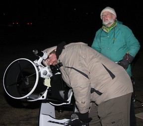 Tim Giese, left, chair of the Cochrane Environmental Action Committee, and Michael Hawkes enjoyed Earth Hour, last Saturday evening, star gazing at the Mitford Pond. The international event involves millions of people and businesses worldwide, who observed the event by turning off their interior and exterior lights for one hour on Mar. 23 between 8:30 and 9:30 p.m.