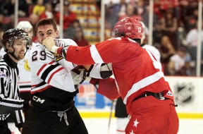 Hounds forward David Broll (right) dukes it out with Owen Sound's Kurtis Gabriel during OHL action at Essar Centre....Rachele Labrecque/Sault Star
