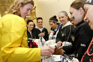 Hockey star Hayley Wickenheiser signs autographs for fans following a training camp session at CFB Petawawa for Canada's National Women's Team in advance of the 2013 IIHF Ice Hockey Women's World Championship taking place in Ottawa.Errol McGihon/Ottawa Sun