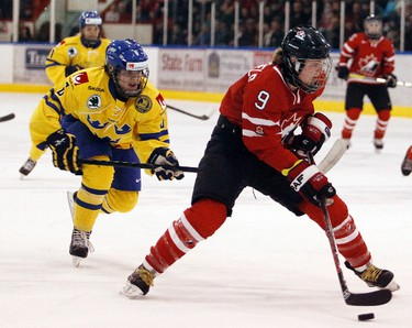Team Sweden`s Lina Backlin, left, chases Team Canada`s Jennifer Wakefield, right, during the first period of play during the 2013 IIHF Ice Hockey World Championships in Pembroke, ON Saturday, Mar. 30, 2013.  Darren Brown/Ottawa Sun/QMI Agency