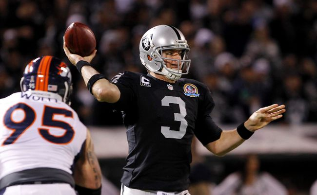 Oakland Raiders quarterback Carson Palmer throws during the first quarter of their NFL football game against the Denver Broncos in Oakland, California December 6, 2012. (REUTERS/Robert Galbraith)