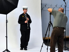 Ordinary Seaman Sarah Currington poses with her clarinet as Sea Cadet alumnus Gilles Portelance takes her picture. Portelance and fellow members of the Porcupine Photo Club visited Royal Canadian Sea Cadet Corps Tiger for a special photo session, held at no cost to the unit.