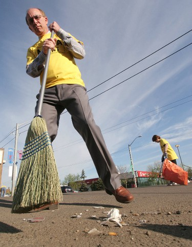 May 16, 2006. Edmonton mayor Stephen Mandel sweeps up garbage on the sidewalk during the Alberta Avenue Business Associations second annual Spring Street Sweep kick-off at Coliseum Steaks & Pizza at 8015 118 Ave., in Edmonton on Tuesday morning. The goal of the initiative is to encourage businesses and the community to keep their store fronts and property clean. Edmonton Sun/QMI Agency