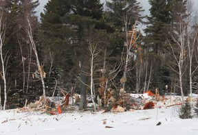 The splintered remains of Cottage No. 10 at Lucquer Lake were spread throughout the property and out onto the lake itself on Tuesday afternoon. Officers from the South Porcupine detachment of the OPP, Forensic Investigation Units and representatives from the office of the Ontario Fire Marshall sifted through the rubble to determine the cause of the explosion.