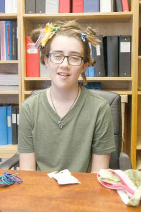 Erin Steele/R-G  In an attempt to entice fellow students to donate money to his decision to shave his head for Weíre Hair For a Cure, Grade 8 Glenmary student Patrice Simoneau allowed the sub-house that raised the most money to style his hair in any way they would like. This is Tuesday's result.