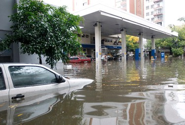 Submerged cars in a flooded gas station are seen after a rainstorm in Buenos Aires on April 2, 2013. (REUTERS/Enrique Marcarian)