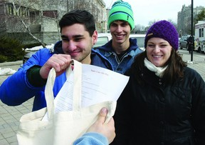 Queen's University students (l-r) Jesse Cranin, Marin MacLeod and Clyton MacLeod have been busy promoting their Meal in a Bag program on Queen's campus.      Rob Mooy - Kingston This Week