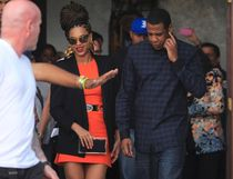 U.S. singer Beyonce and her husband rapper Jay-Z, are escorted by bodyguards as they leave their hotel in Havana April 4, 2013. REUTERS/Enrique De La Osa