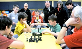 Lucas Piorro, 11, left, contemplates his next move as opponent Zackary Lewis, 12, advances his chess piece during the Chatham Chess Challenge, Tuesday. PHOTO TAKEN Chatham, On., Tuesday April 09 2013. DIANA MARTIN/ THE CHATHAM DAILY NEWS/ QMI AGENCY