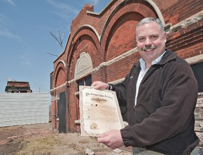 BRIAN THOMPSON, The Expositor  Rob Adlam, past-president of the Canadian Industrial Heritage Centre, holds a replica of a scroll made at the completion of the Cockshutt Plow Co. complex on Mohawk Street more than 100 years ago.  Efforts are underway to negotiate a lease with the city so that the CIHC can use the timekeeper's building and remaining portico in the creation of an interpretive centre showcasing Brantford's manufacturing history.