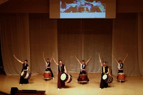 Japanese drummers salute the crowd at the 2012 Stand Up for Love benefit concert at the Ellerslie Road Baptist Church. PHOTO SUPPLIED
