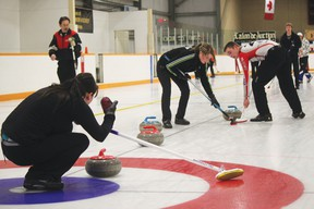 Sheena Read  Editor Dacey Brown offers direction and encouragement to Courtney Missikewitz and Joel Berger, while Jeremy Harty watches. Team Harty won this game against Team Sjogren, and went on to win the A Event of the Nanton Curling Club's annual Meatspiel April 7.