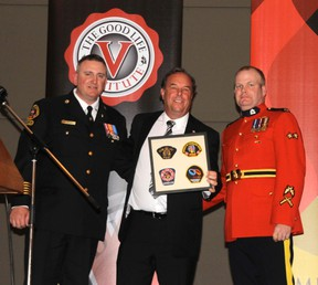 From Left: Vermilion Fire Chief Bill Roth, 9-11 survivor and former FDNY Fire Chief Richard Picciotto, and RCMP Sgt. Mike McGinley gather for a photo after presenting Picciotto with a token of appreciation for coming to Vermilion to share his story.