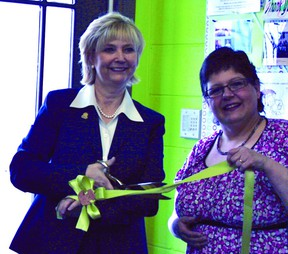Mayor Gale Katchur helps to cut the ribbon during last weekend's unveiling of the new Little Rascals Trading Post.  Photo Supplied