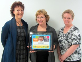 Vice-principal Sheila Henderson, grade three teacher Vicki Hooke, and administrative assistant Edith Bluhm stand with the certificate that Ecole Crescentview School received from UNICEF as the second highest fundraiser in schools across Canada. Hooke noted the honour was really a team effort by the entire school. (ROBIN DUDGEON/THE GRAPHIC/QMI AGENCY)