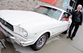 Janet Brooks, housewares manager at Canadian Tire, gets the feel of the 1965 Mustang Fastback with Barry Fraser, for the Rotary Club of Chatham's 13th Annual Mustang Car Raffle. The car will be on display, with tickets available, in front of the Canadian Tire on Grand Ave. West until Sunday. (DIANA MARTIN, Chatham Daily News)