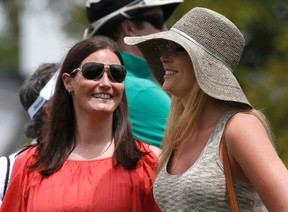 Skier Lindsey Vonn (R), girlfriend of Tiger Woods, looks on with physical therapist Lindsay Winninger during first round play in the 2013 Masters golf tournament at the Augusta National Golf Club in Augusta, Georgia, April 11, 2013. (REUTERS/Mike Segar)