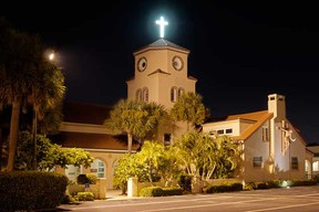 Internet photo  A photographer had noticed that, from just the right spot, the Church by the Seas's highest windows resemble eyes, and some roofing tiles have the look of wings and a beak.